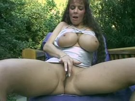 Milf squeezing dick by her huge melons outdoors