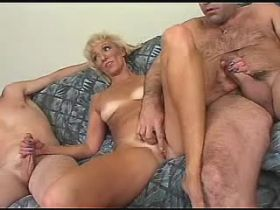 Two men have fun with blonde mature in all holes