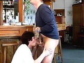 Milf has fun with man on floor of bar in all poses