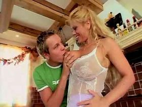 Blonde milf with big tits gets oral sex with guy
