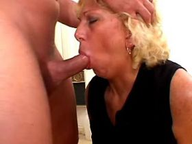Cum flows on face of blonde mature after anal fuck