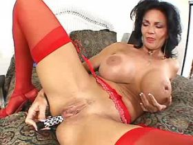 Mature in red stockings plays with dildo and sucks cock
