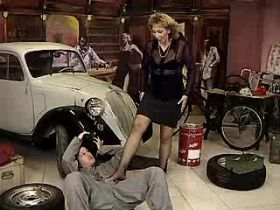 Depraved redhead mom does blowjob in car workshop