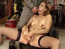 Depraved mom fucks in car workshop and gets facial