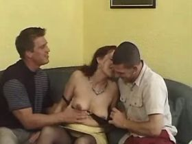 Two guys sharing brunette mature in diff positions