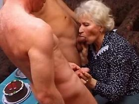 Granny sucks cocks and gets licking pussy in orgy