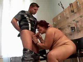 Chubby mom fucks on table in kitchen and gets facial
