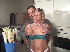 Aged blonde mature does blowjob and fucks in kitchen